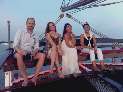 people sitting in flying seat and smiling royal albatross