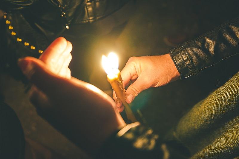 man holding a candle royal albatross