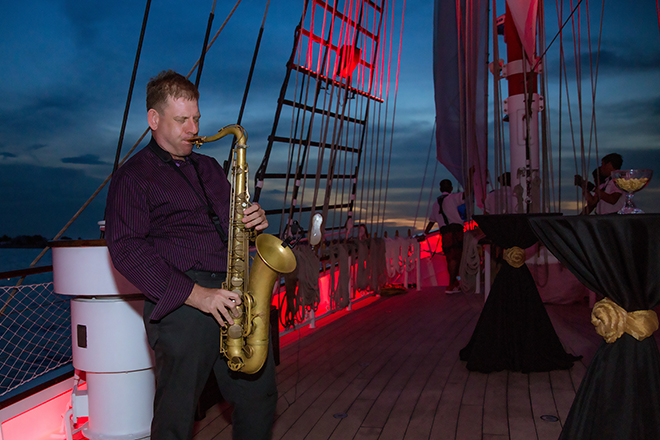 live saxophone playing jazz on sunset sail royal albatross