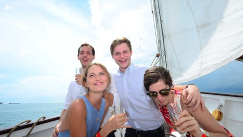 sunset sail drinks with happy guest royal albatross