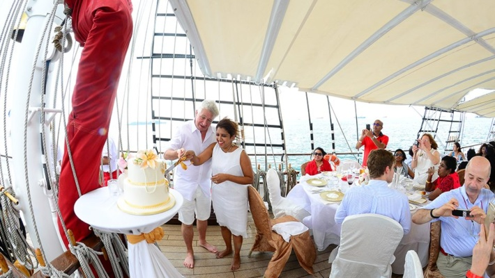 bride and groom cutting cake royal albatross