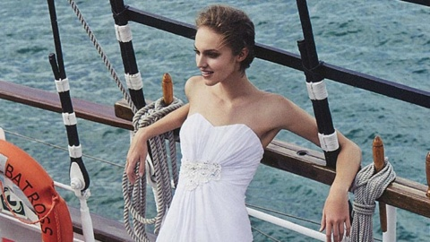 bride leaning on the ship deck royal albatross