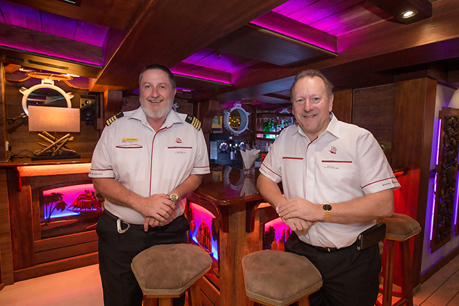 captain duncan and pete pele in grand salon on royal albatross