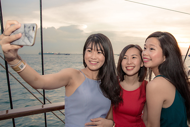 girl friends taking selfie in royal albatross