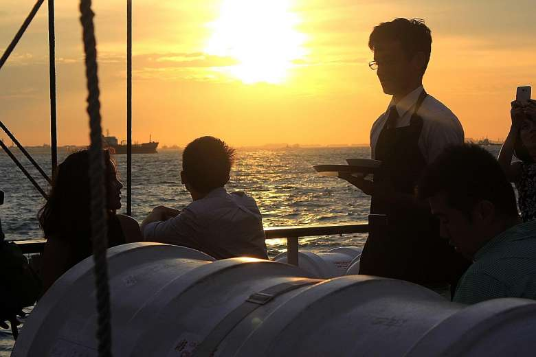 guest being served on sunset sail royal albatross