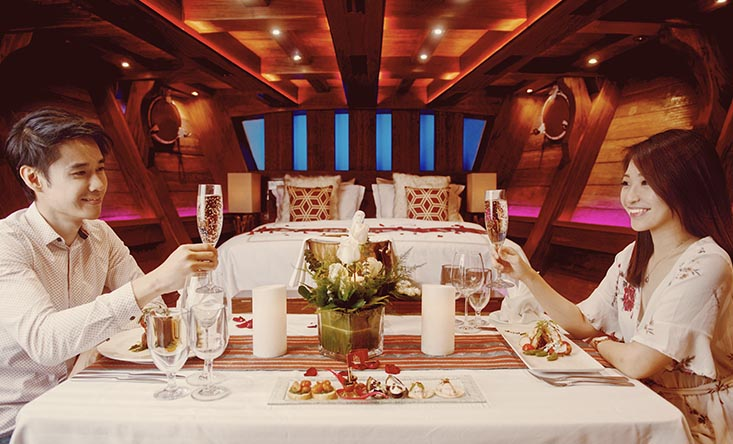 romantic couple anniversary dining in the cabin royal albatross