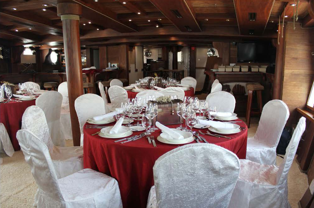 royal albatross grand salon with table set up for guests