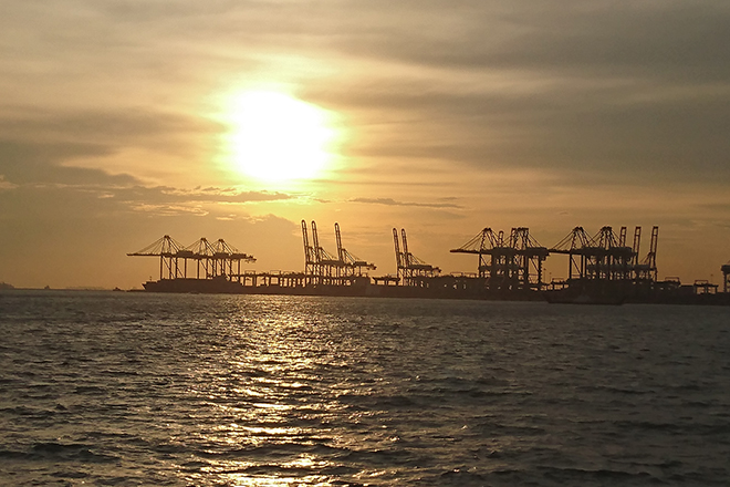 sunset with port silhouette in singapore royal albatross